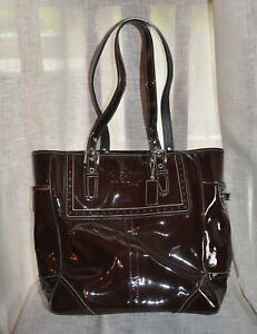 *Coach* Brown patent leather handbag with silver details