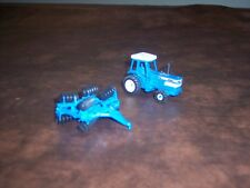 ERTL - FORD - VINTAGE- 1/64 SCALE - FORD TW35 TRACTOR AND FIELD CULTIVATOR