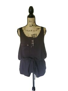Super cute and comfy black racerback romper with front and back pockets Size L