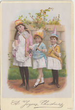 Antique Christmas card showing 3 girls dressed up for a party
