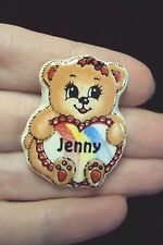 little brown Bear holding personalized Jenny ceramic rainbow heart tac pin