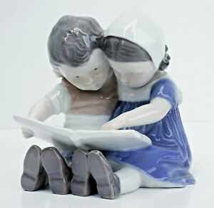"Bing & Gröndahl Children's Figurine,"" Siblings With Picture Book "",Nr.1587."