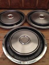 "THREE VINTAGE PLYMOUTH VALIANT 14"" HUBCAPS"