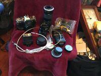 CANON AV-1 35mm SLR CAMERA W/ EXTRA LENSES and accessories