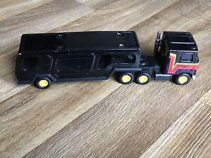 VINTAGE 1980 BUDDY L TIN PLATE TOY, CAR TRANSPORTER, MACK SEMI TRUCK, BLACK.