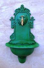 fuente de hierro pared con grifo de laton, verde ingles, jardin