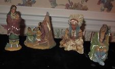 FOUR AMERICAN INDIAN RESIN FIGURINES: FAMILY TEEPEE CHIEF WOMEN; SOME TAGGED