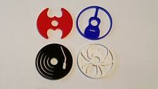 Set of 4 novelty plastic 45 RPM adaptors for centre spindle hole