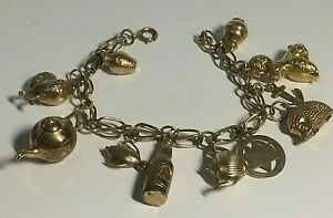 VINTAGE 9 CT YELLOW GOLD LADIES CHARM BRACELET, 11 X CHARMS, 24.60,GRAMS,