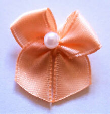 10 SMALL RIBBON BOWS  (Peach).
