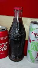 Vecchia bottiglia coca cola in vetro chiusa con tappo originale