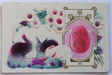 Old embossed postcard EASTER GREETINGS, flowers, rabbits bunnies eating carrot