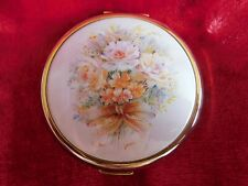 Vintage Stratton compact gold tone with flower design