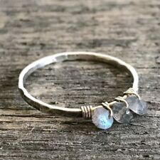 Handcrafted sterling silver ring wrapped with labradorite.  Size Q