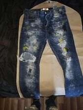 Guess distressed painted jeans
