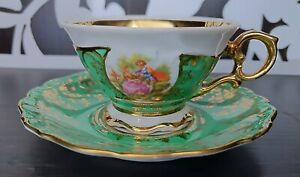 Dresden Royal Vienna Romance Scene gold and green demitasse cup and saucer.