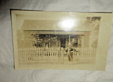 1900s Man in Dungarees in Front of His Modest One Story House Wood Fence Garden