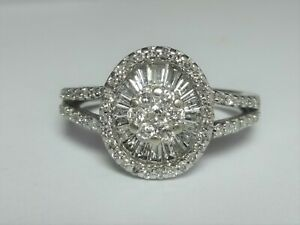 18CT WHITE GOLD 0.87CT OVAL DIAMOND CLUSTER RING