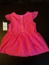 Baby's Dress in pink size 0-3 months uk.
