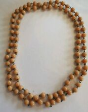 Vintage long coral coloured glass bead necklace