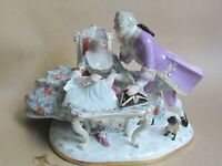 DRESDEN / CONTINENTAL PORCELAIN FIGURE OF SEAMSTRESS, SUITOR & PUG DOG (Ref5058)
