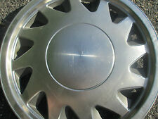 one genuine 1988 to 1990 Plymouth Sundance hubcap wheel cover