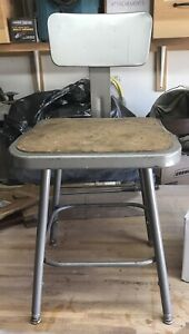Vintage Industrial Adjustable Stool With A Backrest And Square Seat.