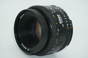 Nikon AF Nikkor 50 mm f/1.8 lens with front and rear caps, early version