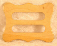 shaped plastic belt buckle 2 inches across in brown vintage