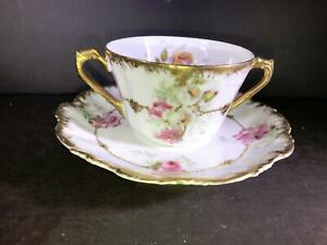 K) LIMOGES FRANCE CORONET SOUP CUP AND SAUCER PINK FLOWERS GOLD TRIM