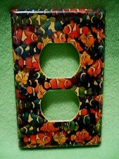 Vintage colorful School of Clown Fish wrapped paper outlet cover.