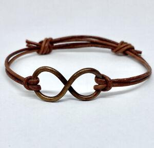hammered antiqued copper infinity bracelet in soft brown leather adjustable