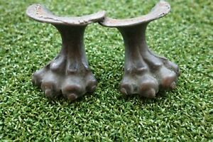 PAIR OF BRONZE SMALL CLAW FEET POSSIBLY CASTER COVERS APPRX 2 INCHES TALL