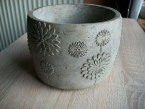 Concrete flower pot. Daisy pattern .145mm x 100mm high.Natural finish.