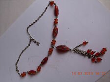 Ethnic beaded necklace, red beads with filigree wrap around 18 inch