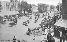 F28/ Rocky Ford Colorado Postcard 1908 Main Street Busy Stores Wagons