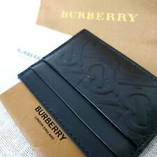 New Authentic Burberry Black Wallet 4 Card Slots and center slip pocket.