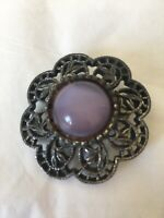 Vintage silver tone flower brooch with purple stone inlay
