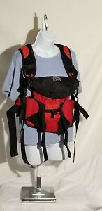 Cherry colored kangaroo Kelty pack for infants 8 to 25 pounds