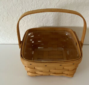 LONGABERGER 1999 MEDIUM BERRY BASKET WITH SWINGING HANDLE AND PROTECTOR