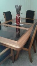 Warm Oakwood dining room table and chairs