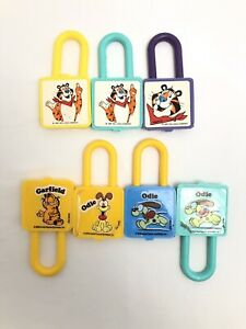 Vintage Lot of 7 Kellogg's Cereal Odie, Garfield & Tony The Tiger PadLock Toy