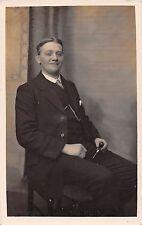 Smiling man, studio RP, J.H.Cross, Frodsham, Cheshire, c 1915, pipe, chain Q2095