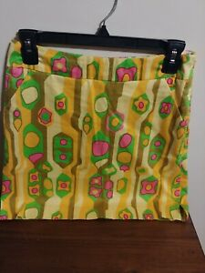 Loudmouth ladies golf skirt 70's inspired yellow mod sock it to me print size 2