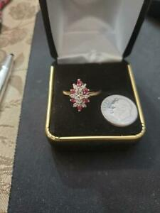 LADIES RUBY AND DIAMOND RING IN 14 K YELLOW GOLD . 60 TCW
