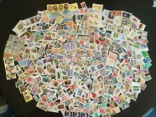 Worldwide Postage Stamps 100 g on paper