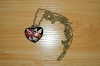 Vintage costume jewellery enamelled heart shaped floral pendant on long chain.