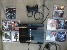 Sony PlayStation 3 black console 55GB  8 games and controller Tested Working