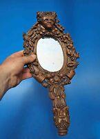 face à main en bois sculpté d'une tête végétale -  miroir - art populaire
