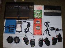 ATARI 2 CONSOLES CX-2600 WOODGRAIN/ATARI 2600 FLAT BLACK W/74 GAMES USED